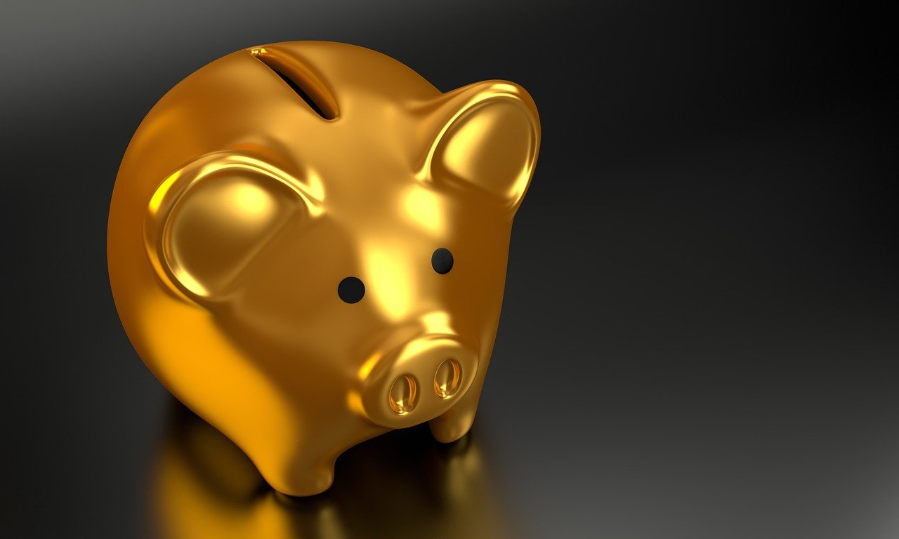 A gold piggy bank represents gold investments.