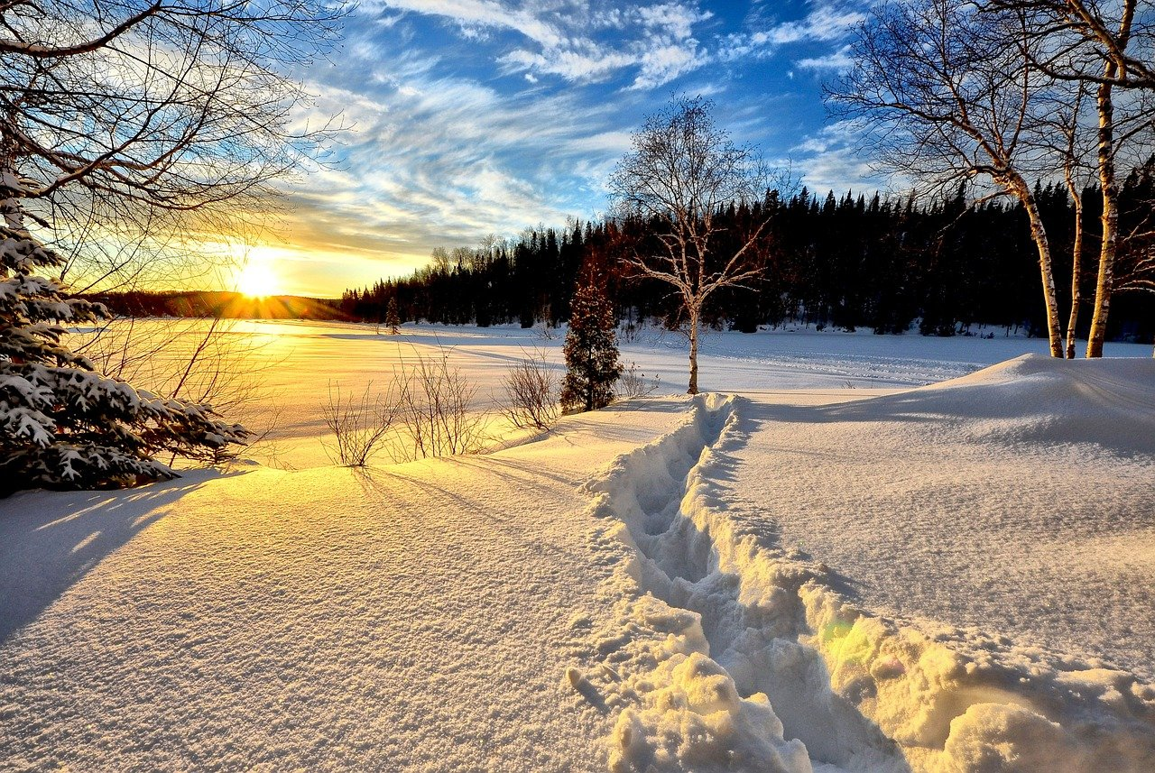 A snowy landscape at sunset.